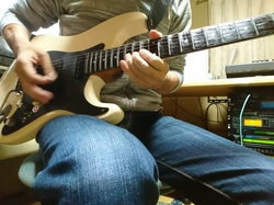 Playing Stratocaster